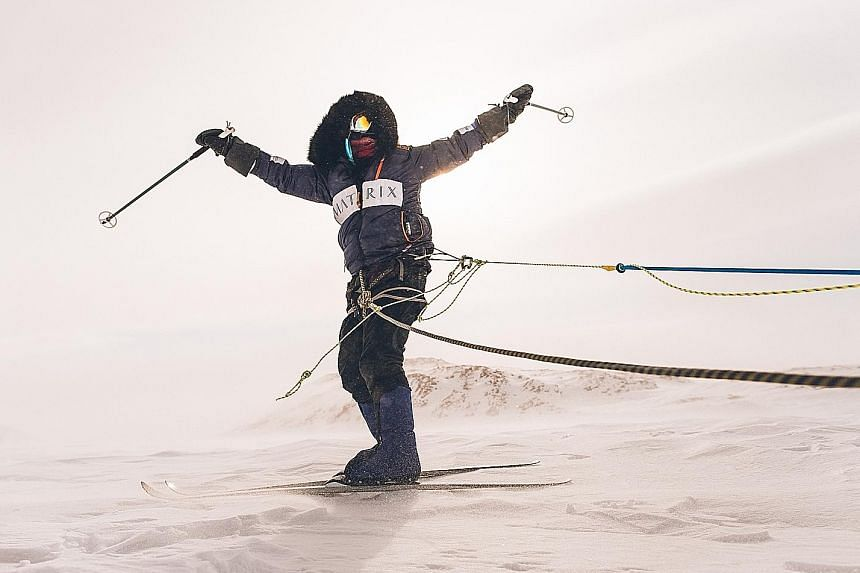 Ms Eirliani Abdul Rahman learning polar survival skills in the frozen Canadian north to prepare for her South Pole expedition in December next year. Her training includes cross-country skiing as well as dragging and flipping a 25kg truck tyre up and