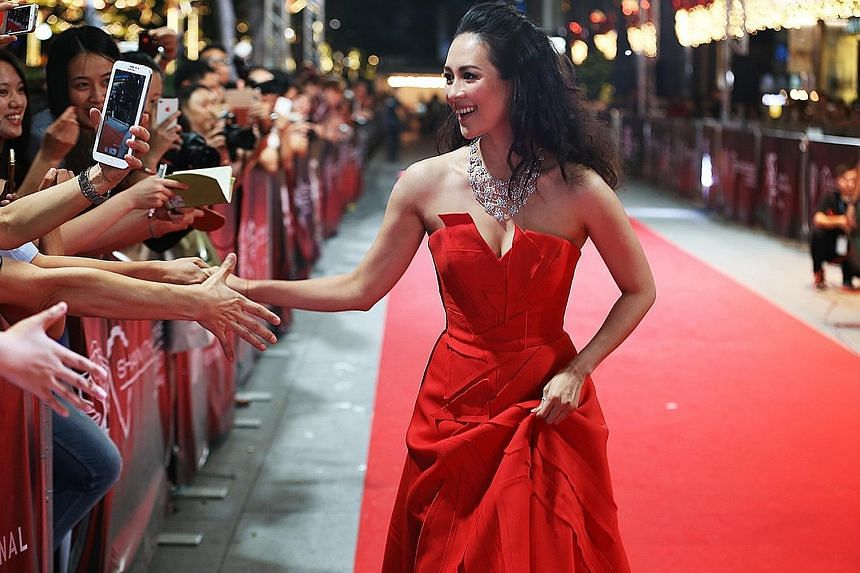 Above: Actress Zhang Ziyi walking the red carpet at the 2014 edition of the festival.