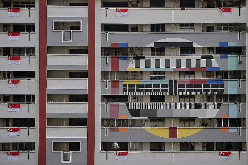 Viewed from the front or back, this arrangement between blocks 107 and 109, Lorong 1, Toa Payoh, still reads 52. Block 603, Hougang Avenue 4, is all a-flutter over National Day. Turning 52 is the icing on this cake outside Block 178, Woodlands Street
