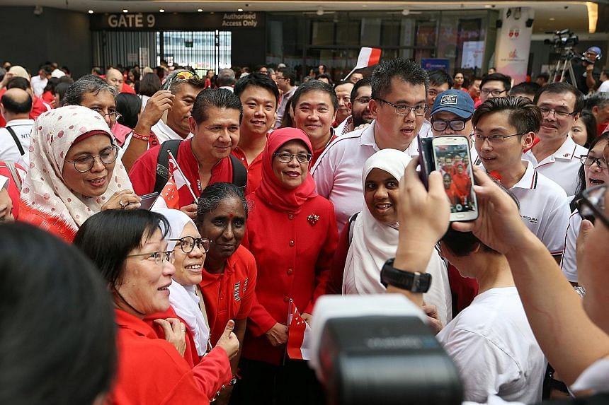 Madam Halimah Yacob with union leaders at the NTUC National Day Observance Ceremony at Our Tampines Hub yesterday. It was her first appearance at a union event after she announced her intention to contest in the upcoming presidential election.
