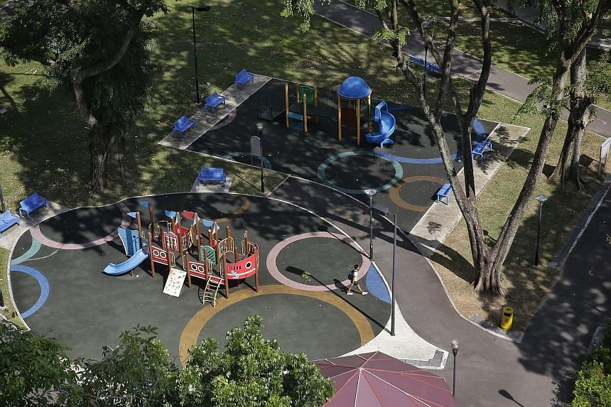 Ms Lin Shiyun (centre, in blue and white top) started Let's Go Play Outside! for children from low-income families in Toa Payoh Lorong 1, where there are some blocks of rental flats and a park with two playgrounds (below). Initially, the activities w