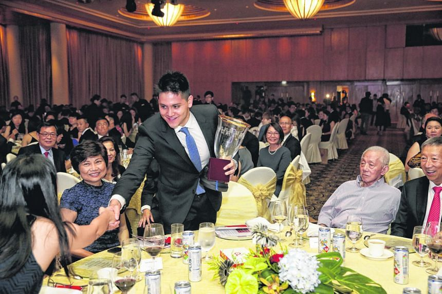 Sportsman of the Year Joseph Schooling being congratulated by Singapore shooter Jasmine Ser after collecting his award. It is the third straight year he has won the accolade.