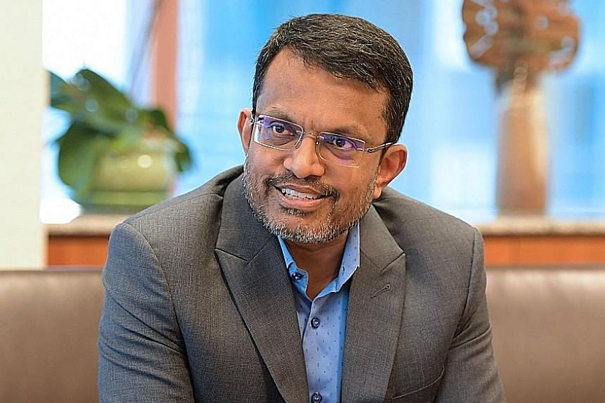 """Mr Ravi Menon dedicates his award to all those who he has worked with in the last 30 years, in MAS, MTI and MOF. """"It is a tribute to their commitment to excellence and fidelity to the public cause,"""" he says."""