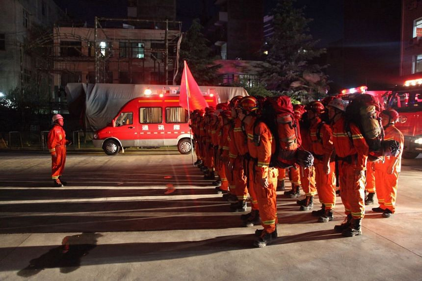 Firefighters in China's Gansu province prepare to head to Wenxian county after a quake centered in neighbouring Sichuan province.