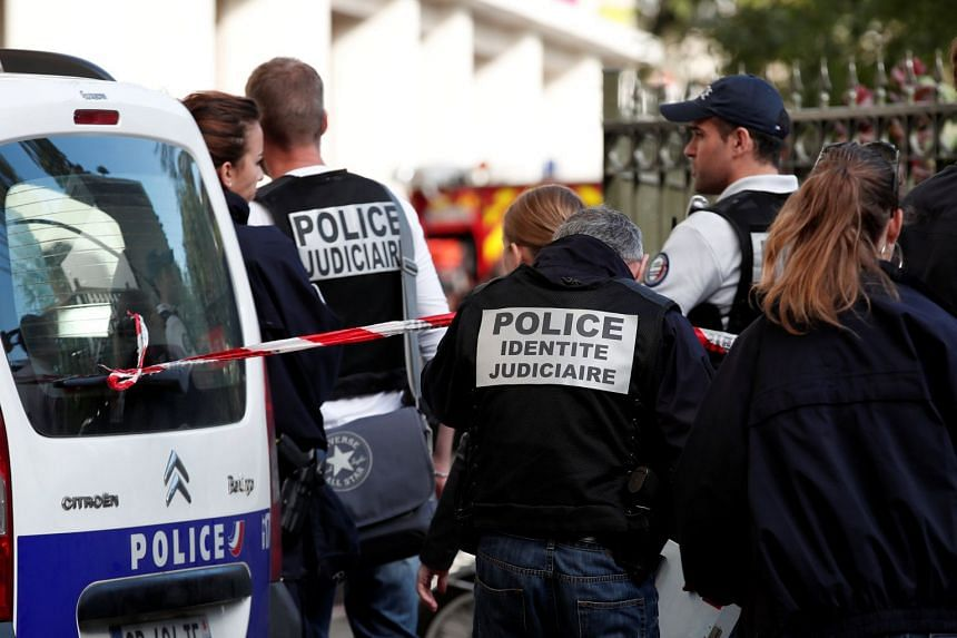 Police officers working at the site where six French soldiers were injured by a vehicle that hit them, in the Parisian suburb of Levallois-Perret, on Aug 9, 2017.