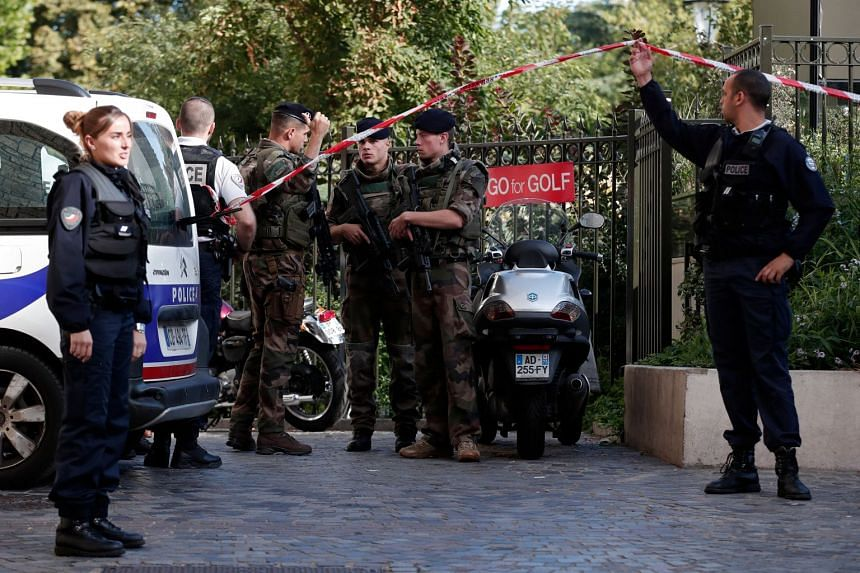 French police and soldiers securing the area after a vehicle hit several soldiers, leaving six of them injured, in the Parisian suburb of Levallois-Perret, on Aug 9, 2017.
