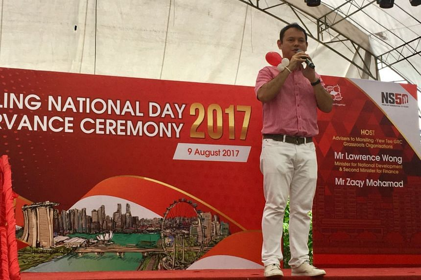 Chua Chu Kang GRC MP Zaqy Mohamad addressing residents at the Marsiling constituency's National Day celebrations.