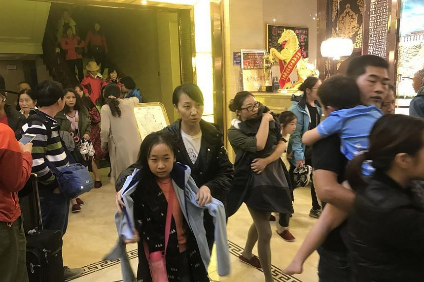 Tourists evacuating from a hotel in Ruo'ergai in south-west China's Sichuan province, on Aug 8, 2017.