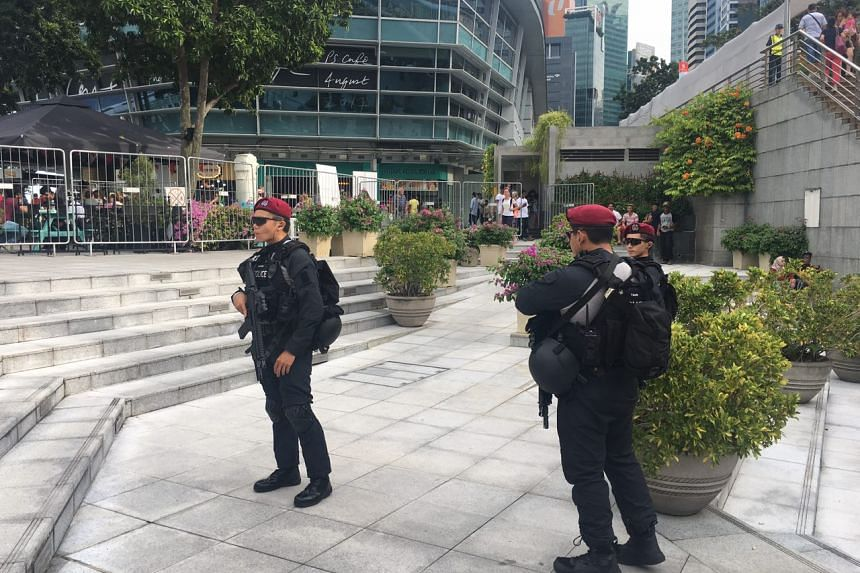 Security officers standing guard at Merlion Park, ahead of the National Day Parade on Aug 9, 2017.