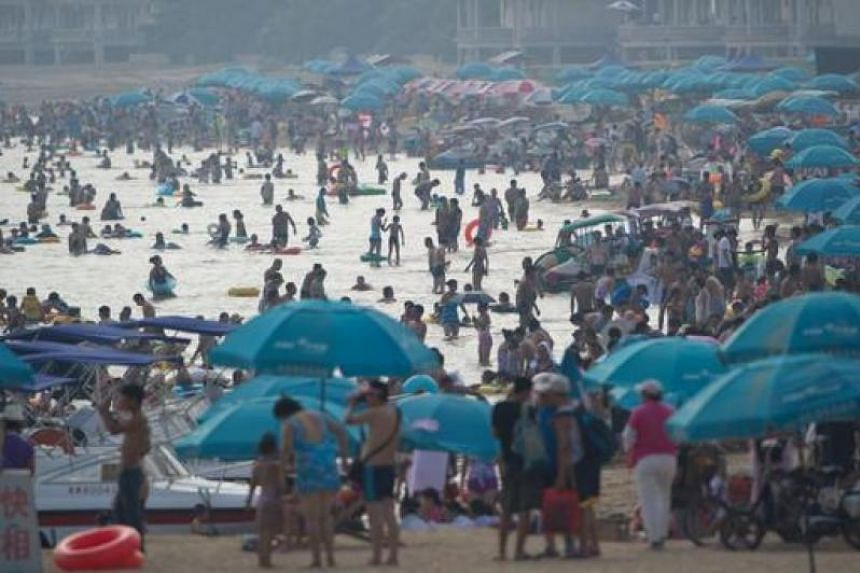 A general view shows holiday-makers on a beach at the seaside town of Beidaihe, 100 kms (60 miles) east of Beijing on August 6, 2012. China's leaders, including the man expected to be the next president, are believed to have begun their secretive sum