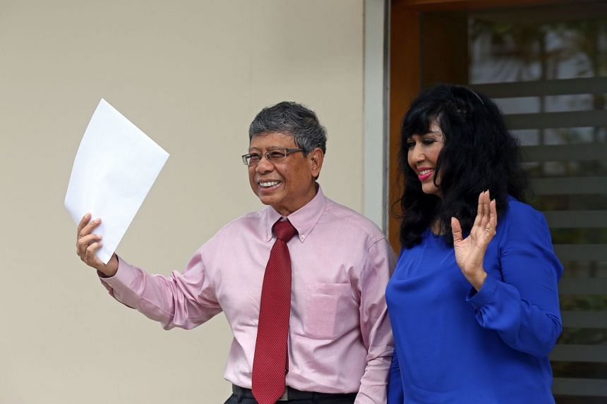 Second Chance Properties CEO Mohamed Salleh Marican with his wife Sapiyah Abu Bakar after collecting application forms for this September's presidential polls at the Elections Department on June 5, 2017.