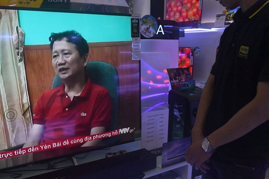 A TV screen at a Hanoi shop shows Trinh Xuan Thanh speaking in a clip aired by Vietnam's state television VTV.