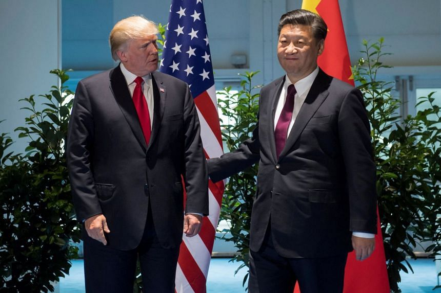 Trump and Chinese President Xi Jinping (right) meet on the sidelines of the G-20 Summit in Hamburg, Germany, in July 2017.