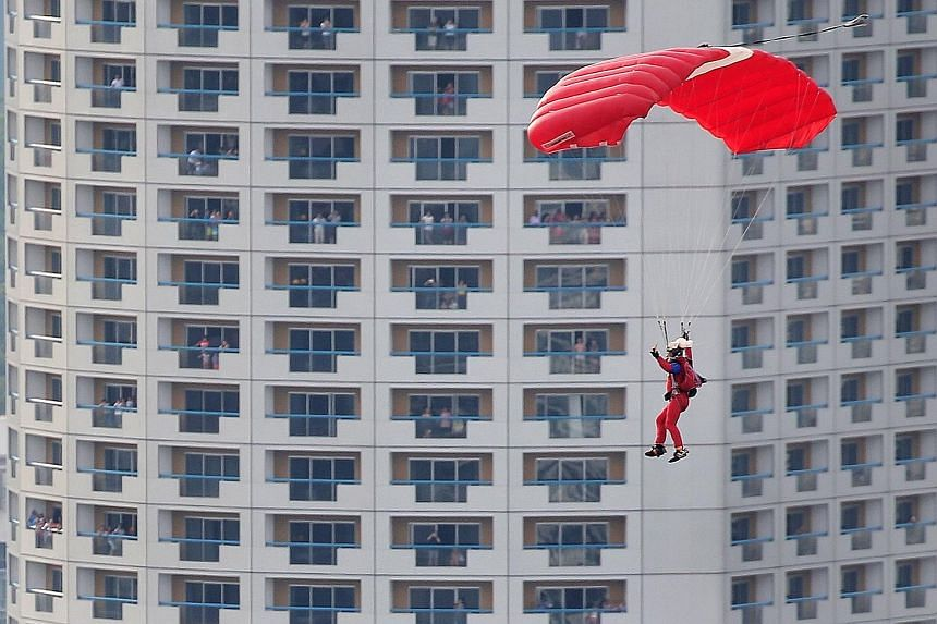 The nine-member SAF Parachute Team, known as the Red Lions, returned yesterday after a two-year break. Last year, the Red Lions could not parachute into the National Stadium due to safety reasons, and at the SG50 parade at the Padang in 2015, the jum