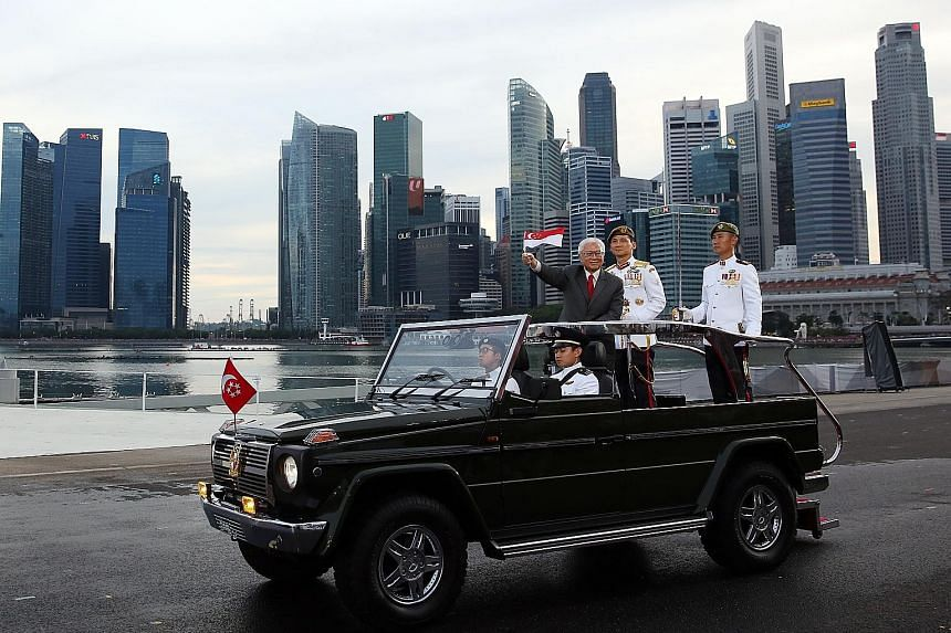 President Tony Tan Keng Yam on the ceremonial Land Rover at the parade. He later told reporters he spent more time than usual thanking the NDP participants. Prime Minister Lee Hsien Loong receiving a warm welcome as he arrives at the parade to take h