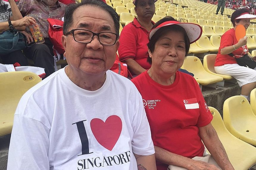 Retiree Edwin Koh, 69, and his wife Theresa Ng, 70, queued from 2pm yesterday, more than three hours before the parade began, to get good seats. It was Mr Koh's first time at the parade since he took part in the first NDP in 1966.