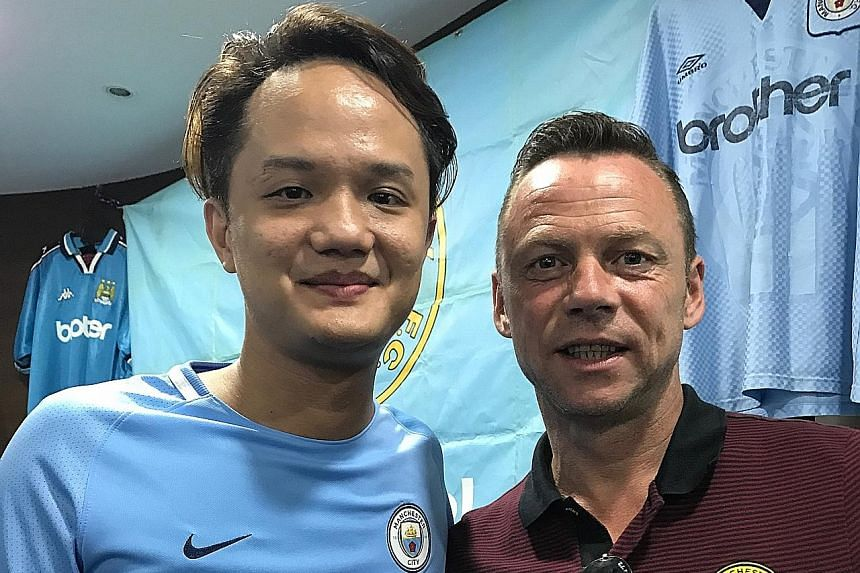 Manchester City FC Supporters Club Singapore treasurer Jess Chen with former City player Paul Dickov. Chen feels that David Silva will be crucial to this season's success.
