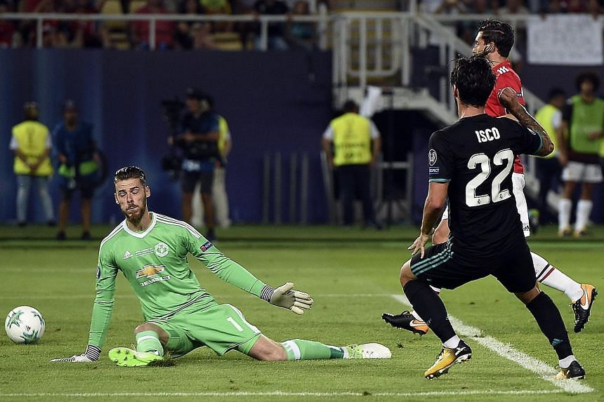 Real midfielder Isco slotting past United 'keeper David de Gea in the 52nd minute in the Uefa Super Cup final. The Champions League winners are the first side to retain the Cup since AC Milan in 1990.