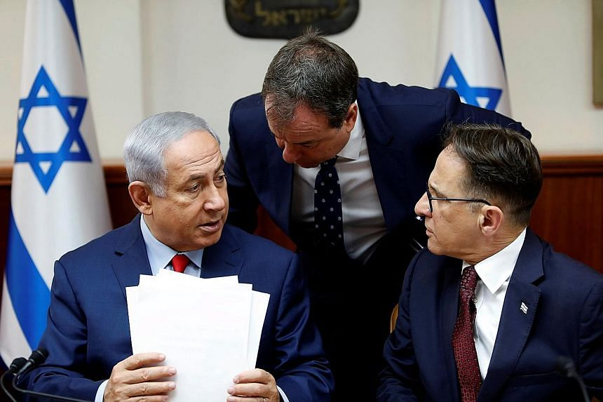 Mr Benjamin Netanyahu (far left) with his advisers at a weekly Cabinet meeting. Suddenly, the long-serving Israeli leader seems not so invincible after all.