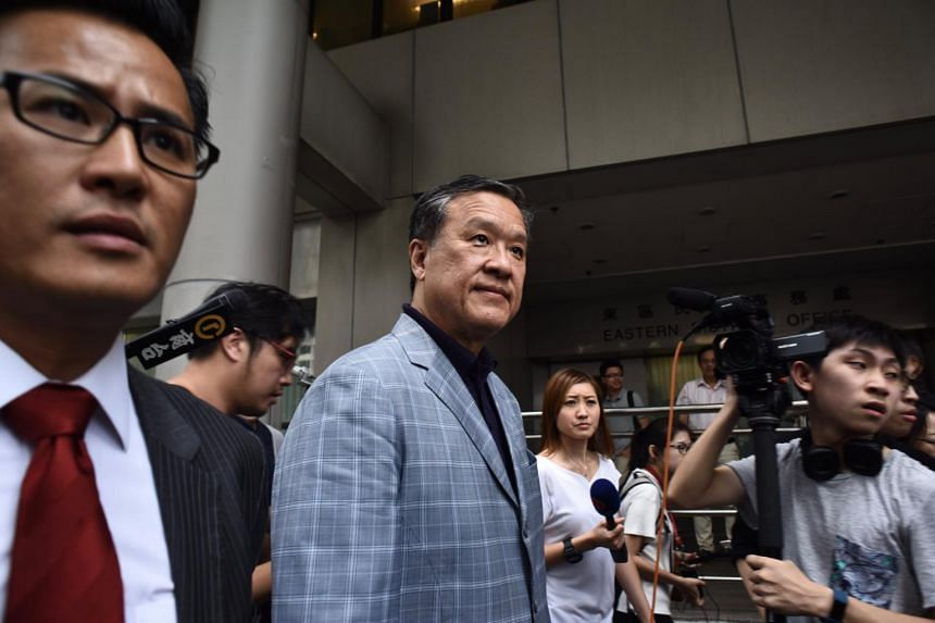 Former executive councillor Barry Cheung (centre) leaving the Eastern Court after being released on bail on Aug 10, 2017.