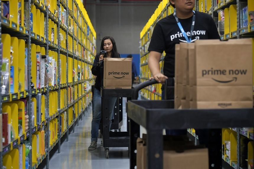 Amazon staff preparing orders at the Prime Now facility at Mapletree Logistics Hub in Toh Guan Road East on July 27.