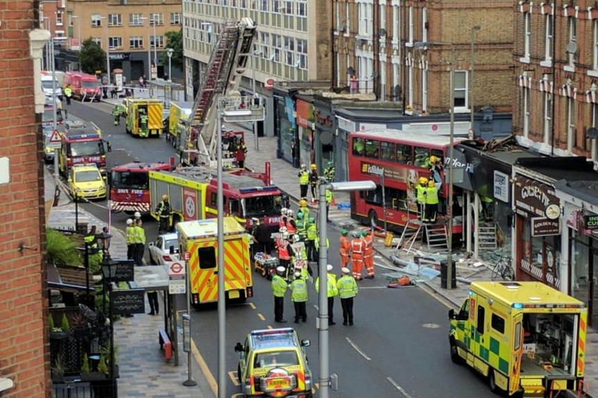 Emergency services attend the scene of a bus crash in Lavender Hill, London on Aug 10, 2017.