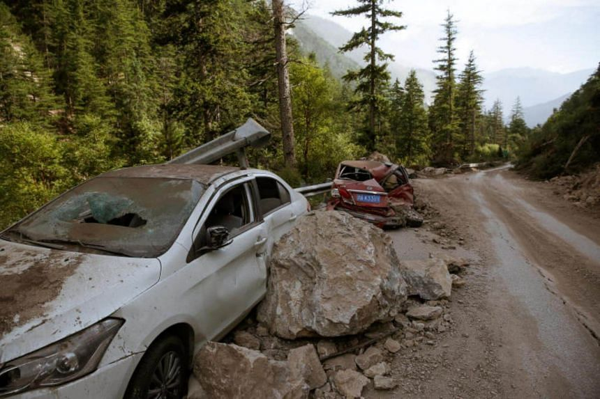Cars are abandoned at the side of a mountain road after an earthquake-triggered rock slide severely damaged them outside Jiuzhaigou, Sichuan province, China on Aug 10, 2017.