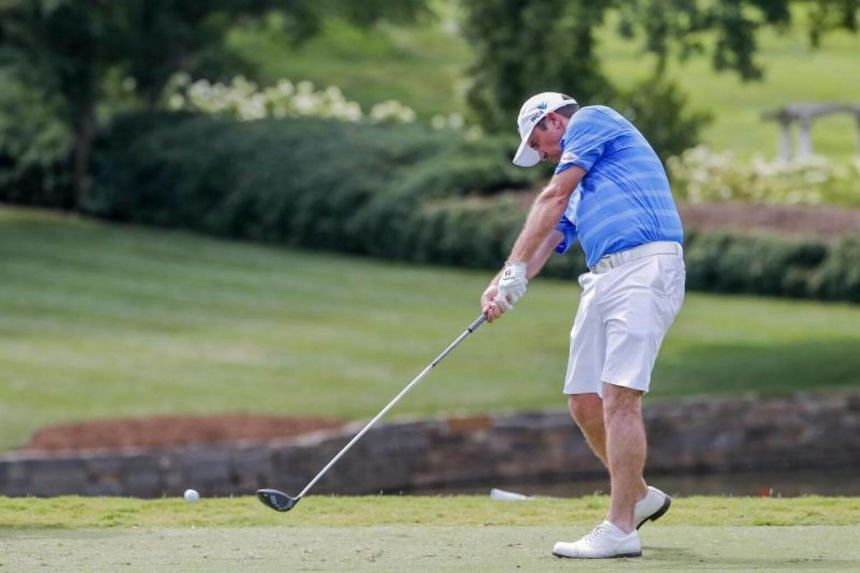 Scott Hend of Australia hits from the eighth tee during a practice round for the 99th PGA Championship golf tournament at Quail Hollow Club in Charlotte, North Carolina, USA on Aug 8, 2017.