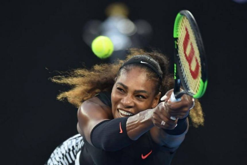 Serena Williams of the US hitting a return against Venus Williams of the US during the women's singles final on day 13 of the Australian Open tennis tournament in Melbourne on Jan 28, 2017.