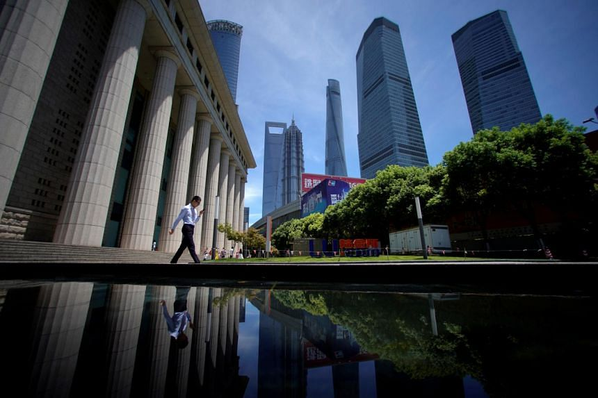 Lujiazui financial district of Pudong in Shanghai. The authorities may continue to favour mergers of weak companies with stronger ones as a less disruptive alternative to outright bankruptcy for large enterprises, given that maintaining high and stab