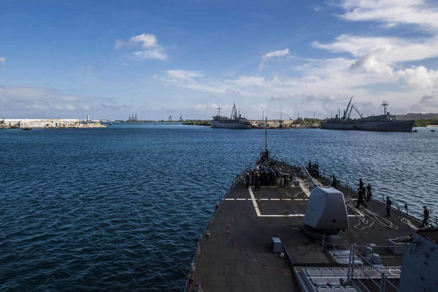 The Arleigh Burke-class guided-missile destroyer USS Barry departing Apre Harbor, Guam, on March 6, 2017.
