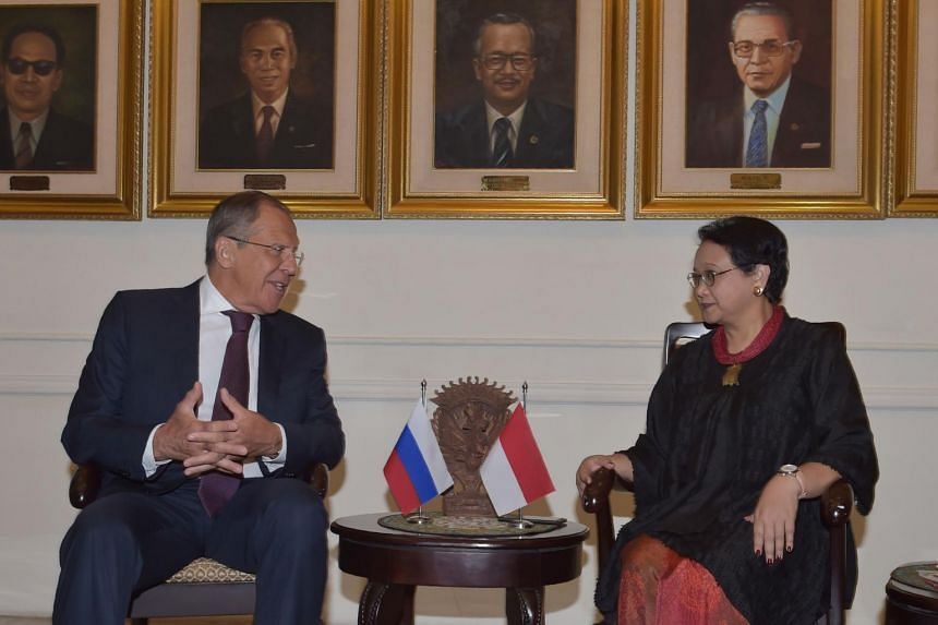 Russian Foreign Minister Sergey Lavrov (left) talks with his Indonesian counterpart Retno Marsudi prior to their meeting in Jakarta on Aug 9, 2017.