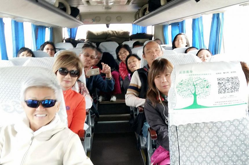 A tour group of 20 people on a coach to Chengdu on Thursday morning (Aug 10), after their stay at Jiuzhaigou was cut short by an earthquake on Tuesday.