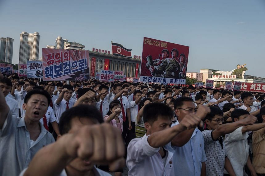 People at a rally in support of North Korea's stance against the US, on Kim Il-Sung square in Pyongyang on Aug 9, 2017.