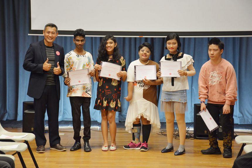 National Youth Council CEO David Chua (far left), with student-models (from second left) Rajkiran Parienan, Batrisyia Nurin Ramdan, Siti Raudhah Jamaludin, Nurul Syuhaidah Mohamed Shalihin and Henry Lim Jia Jun.