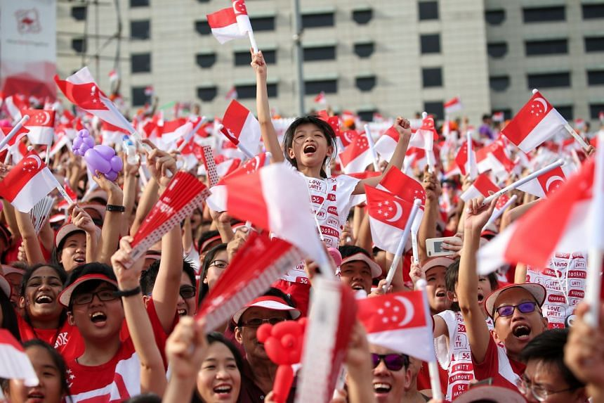 """Nine-year-old Lavelle Tan cheering her heart out at the National Day Parade yesterday. She said: """"I wish Singapore will forever be my homeland."""""""