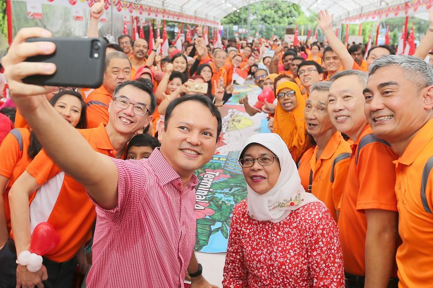 Mr Zaqy Mohamad (left) and Madam Halimah Yacob with residents at Marsiling's National Day Observance event yesterday.