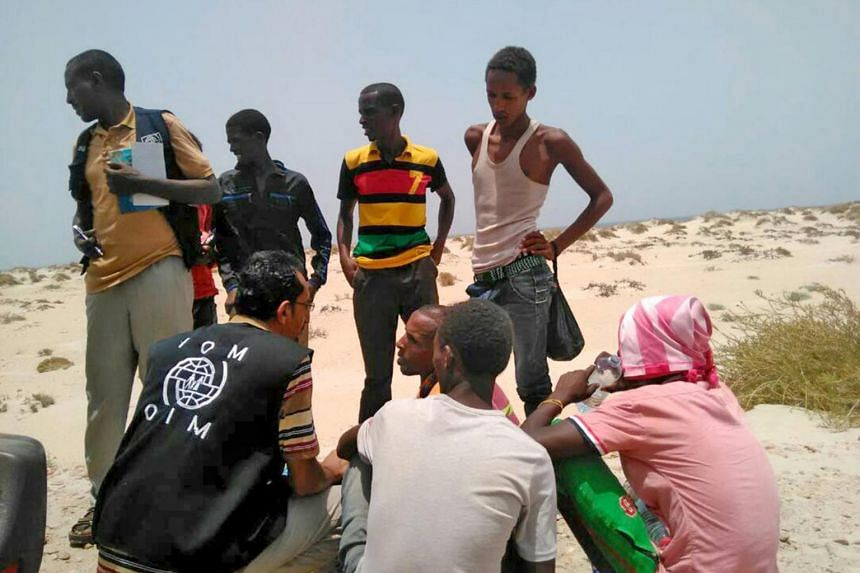 IOM staff assisting Somali and Ethiopian migrants, who were reportedly forced into the sea by smugglers, on a beach in Shabwa, Yemen.