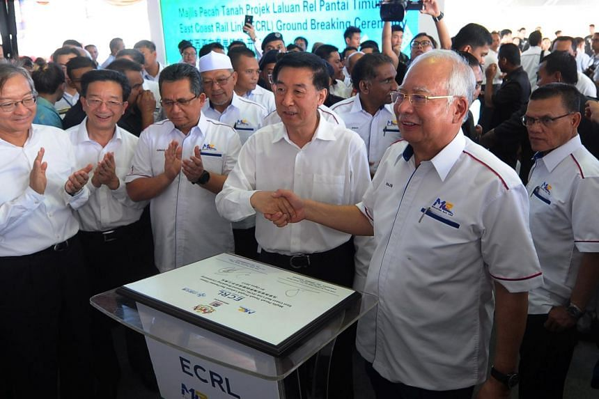 Malaysian Prime Minister Najib Razak (second from right) shaking hands with China's State Councillor Wang Yong (fourth from left) after officiating the groundbreaking ceremony for the East Coast Rail Link project, on Aug 9, 2017.