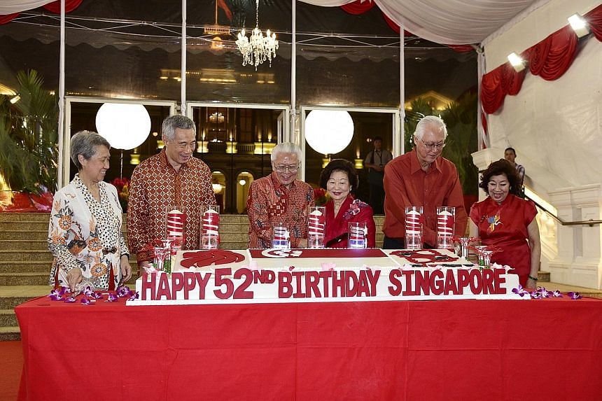 President Tony Tan Keng Yam and Mrs Mary Tan cutting a cake to mark Singapore's 52nd birthday along with Prime Minister Lee Hsien Loong, Mrs Lee, Emeritus Senior Minister Goh Chok Tong and Mrs Goh at the National Day Reception yesterday. Held at the