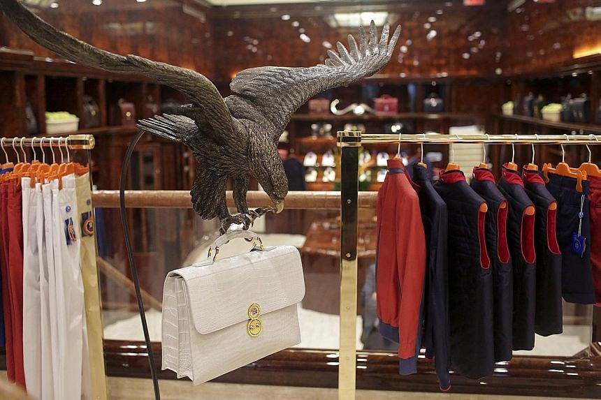 An alligator-skin bag (above) in the clutches of an eagle statue is on display at the Stefano Ricci boutique in New York. The brand's founder Stefano Ricci (left, at his home in Firenzuola, Italy) considers the bird a symbol of strength and control.