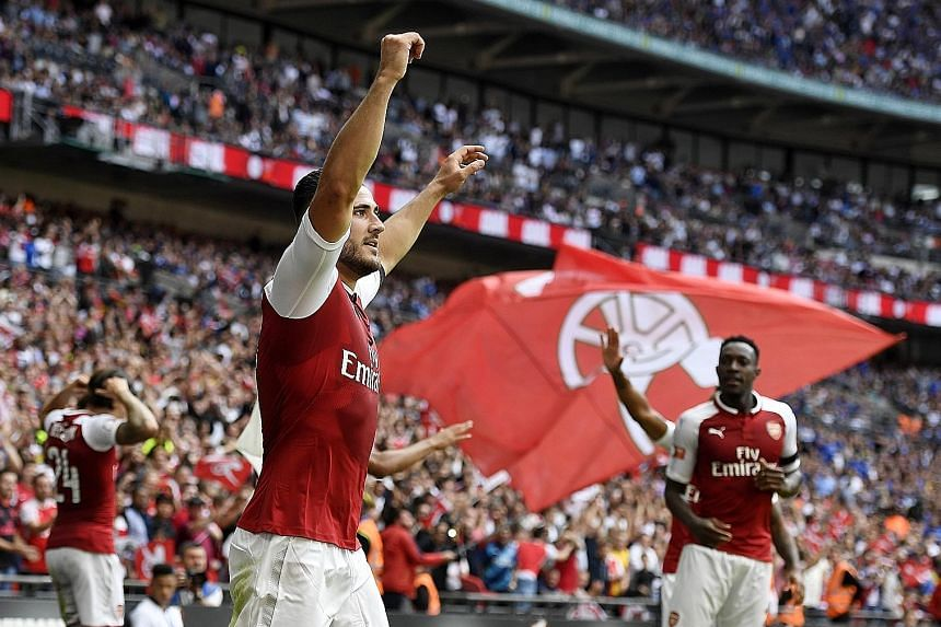 Arsenal left-back Sead Kolasinac celebrating his Community Shield equaliser against Chelsea at Wembley, where they went on to win 4-1 on penalties. The Gunners will be playing in the Europa League this season, having failed to qualify last term for t