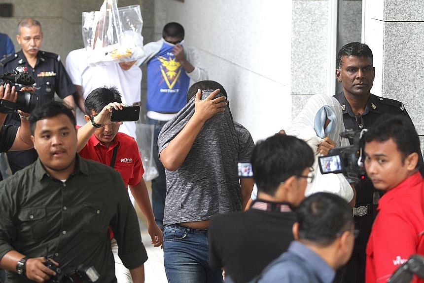 The suspect, who cannot be named to protect the victim, at the Sessions Court in Putrajaya yesterday. He is alleged to have sodomised and raped his 15-year-old daughter more than 200 times in three months.