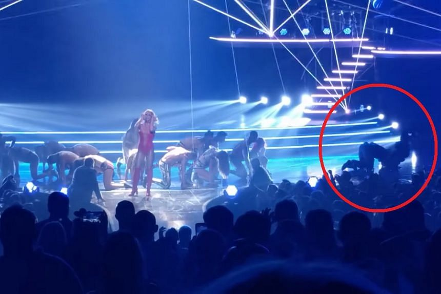 A fan barged onto a stage where Britney Spears was performing on Aug 9, 2017.
