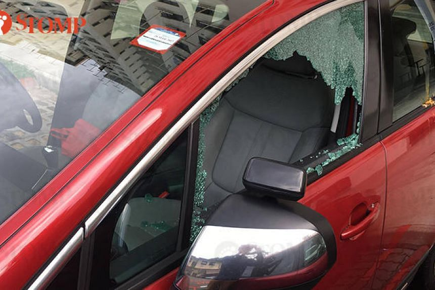 The owner of this car said that he was going to work when he found the left passenger window of his car shattered.