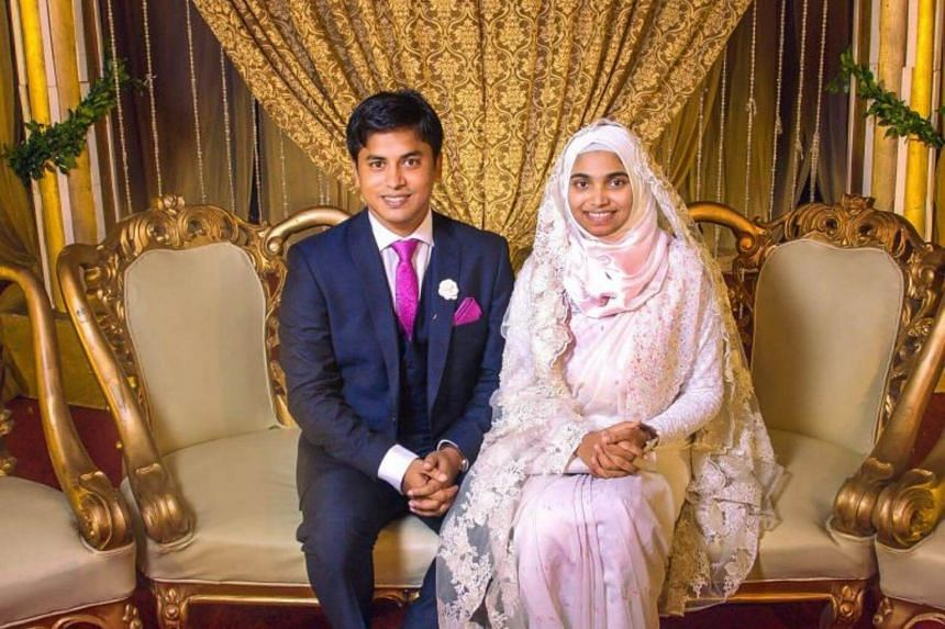Tasnim Jara and her husband pose for a photograph during her wedding party in Dhaka, on Aug 8, 2017.