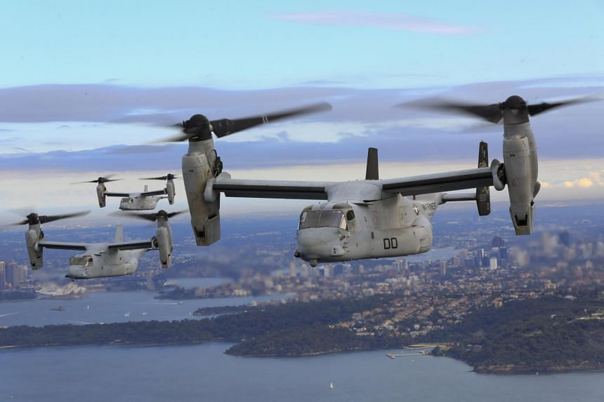 This image obtained from the US Marine Corps shows three MV-22B Osprey tiltrotor aircraft flying in formation above the Pacific Ocean off the coast of Sydney, on June 29, 2017.