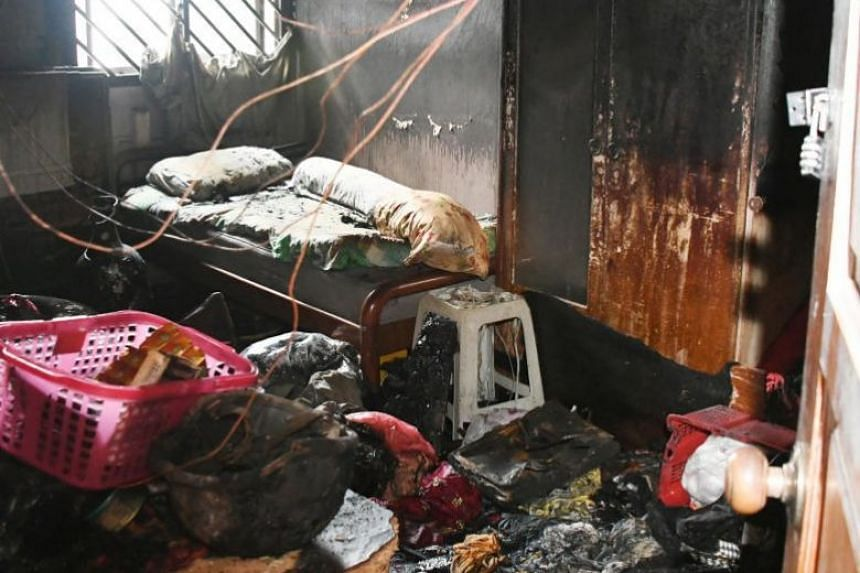 The fire charred the contents of a room in the Aljunied flat.