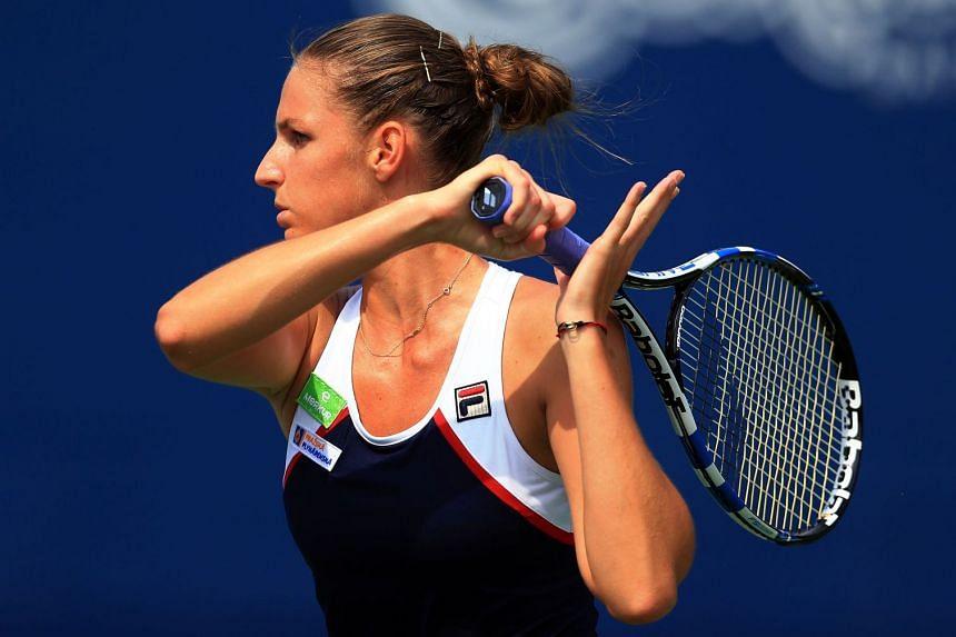 Pliskova plays a shot against Naomi Osaka of Japan.