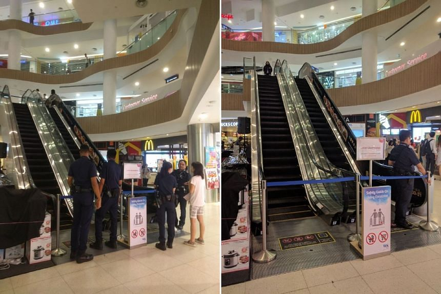The girl, whose right foot was caught in the escalator, was taken to hospital. The escalator was cordoned off when ST visited on Friday night.